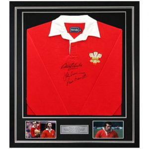 JPR Williams, Gareth Edwards & Phil Bennett Deluxe Framed Signed Welsh Rugby Shirt