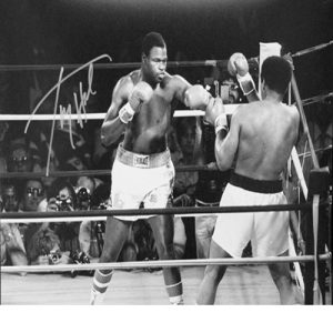 Larry Holmes signed photo vs Muhammad Ali